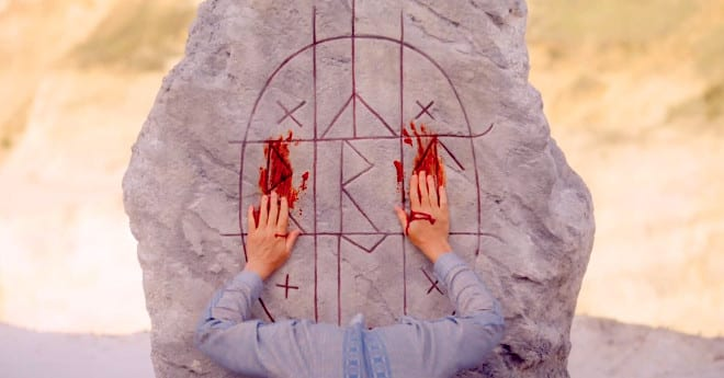Runes smeared with blood in Midsommar review.