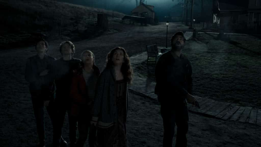 ANNABETH GISH as DR. SARAH GUNNING, IGBY RIGNEY as WARREN FLYNN, ANNARAH CYMONE as LEEZA SCARBOROUGH, KATE SIEGEL as ERIN GREENE, and RAHUL KOHLI as SHERIFF HASSAN in episode 107 of MIDNIGHT MASS
